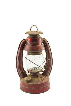 Old classic dusty oil lamp isolated on white background