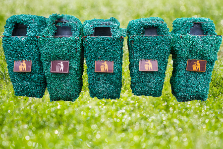 The row of green bin and grass for green earth concept Stock Photo