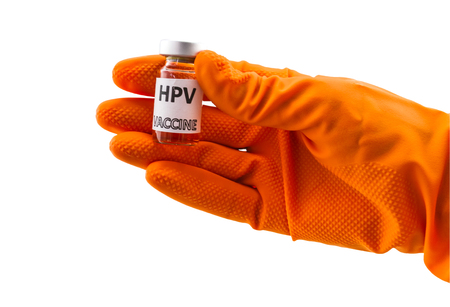 papillomavirus: Bottle vaccine of Human papillomavirus (HPV) vaccine in red  glove  of doctor on white  background.Saved with clipping path.