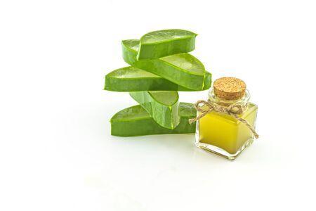 Slice Aloe Vera (Aloe barbadensis Mill.,Star cactus,  Aloin, Jafferabad or Barbados)  and Aloe vera essential oil isolated on white background.
