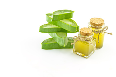 Slice Aloe Vera (Aloe barbadensis Mill.,Star cactus,  Aloin, Jafferabad or Barbados)  and Aloe vera essential oil isolated on white background.Saved with clipping path. Stock Photo