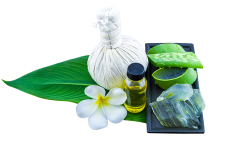 compress: Slice Aloe Vera (Aloe barbadensis Mill.,Star cactus,  Aloin, Jafferabad or Barbados)  Spa compressing ball and Aloe vera essential oil in green leaf on white.Saved with clipping path.