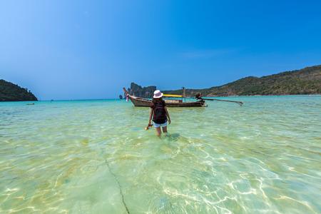 Backpacker woman at tropical beach in Andaman Sea at Krabi, Thailand