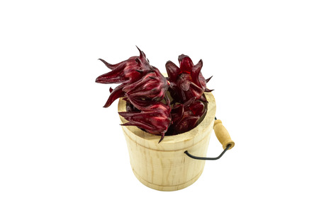 Hibiscus sabdariffa or roselle fruits in wooden box  on white background.Saved with clipping path. Stock Photo