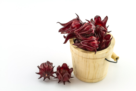 Hibiscus sabdariffa or roselle fruits in wooden box  on white background.