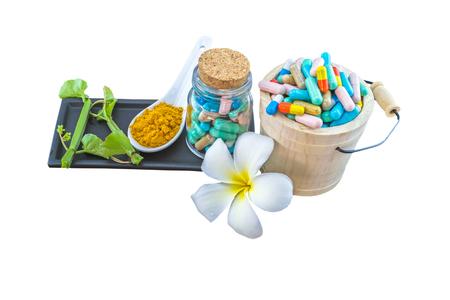 Spa herbal (white frangipani flowers, turmeric powder in white spoon, pill, Cissus Quadrangularis Linn) on white