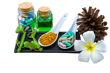 Spa herbal (white frangipani flowers, turmeric powder in white spoon, pill, Cissus Quadrangularis Linn, pine) isolated on white Banco de Imagens