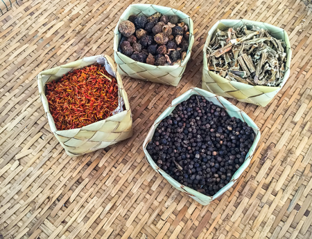 Aromatic spices in coconut weave and bamboo weave. (spices, herbs),soft focus