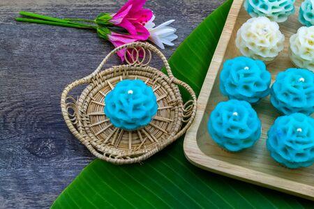 Traditional Thai dessert flower shape stuff with crush soybean and taro (Thai name kanom Chor phaka) in bamboo basket and bana leaf.