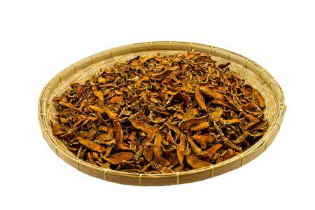 Closed up  dry Curcuma longa or  Turmeric,Curcuma in basket isolated on white background. Stock Photo