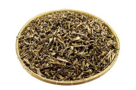 Dry Cissus quadrangularis in basket isolated on white. Stock Photo