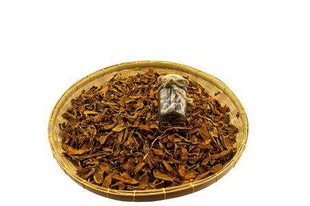 Closed up  dry Curcuma longa or  Turmeric,Curcuma and pill  in basket isolated on white background.