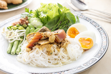 innards: vermicelli noodle with yellow curry, fish innards curry Stock Photo