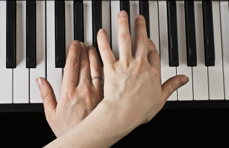 Playing the piano  Women s hands close-up  photo
