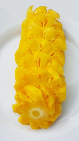 Sliced pineapple on plate