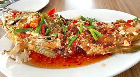 fish with sauce,sour and spicy on white plate,Thai style food