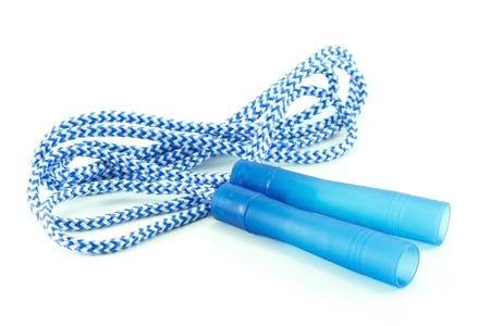 coiled: coiled blue and white striped jump rope with plastic handles on white background