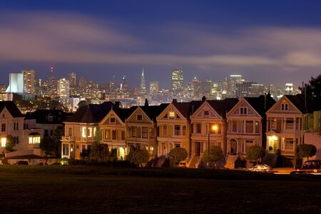 Night lays her garments down on the iconic Painted Ladies backed by downtown San Francisco photo