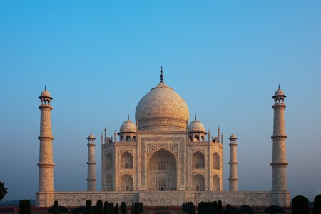 tomb empty: A beautiful daybreak as the iconic Taj Mahal absorbs the morning sunrise colors.