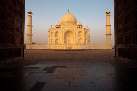 The Taj Mahal at sunrise seen through the Jawabs oversized doorway. photo