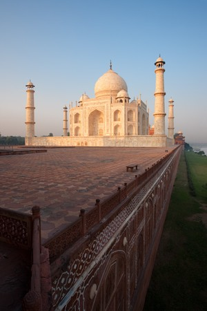 subcontinent: The red sandstone base of the Taj Mahal rises out of the bank of the Jamuna river at sunrise.