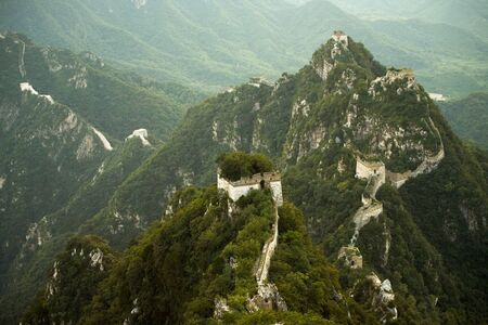 crumbling: The unique white rock Jiankou section of the Great Wall of China hugs the spine of the mountain. Stock Photo