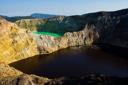 Adjacent green and red/brown volcanic lake at Kelimutu National Park, Indonesia.