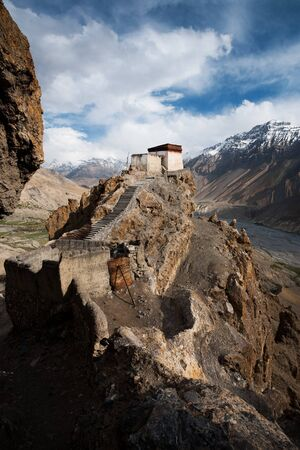 valley below: A small watchtower within the cliffs of Dhankar monastery overlooks Spiti Valley below. Stock Photo