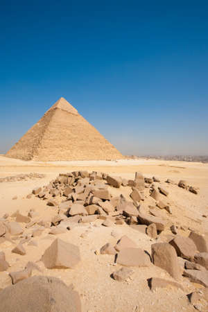 The Great Pyramid of Khafre stands in the desert at the edge of Cairo Giza, Egypt photo