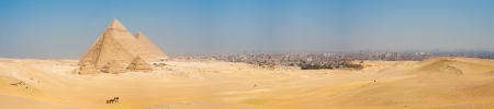 A grand panorama of all of the pyramids at Giza and the city of Cairo, Egypt nearby