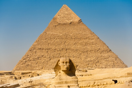 The Great Sphinx aligned perfectly center of the Pyramid of Khafre in Giza, Cairo, Egypt photo