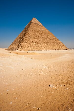 An empty desert in front of the Pyramid of Khafre in Giza, Cairo, Egypt photo
