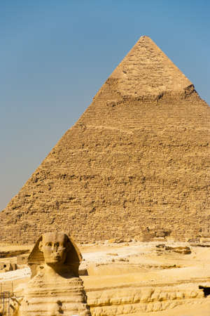 The Great Sphinx is seen backed by the Pyramid of Khafre in Giza, Cairo, Egypt photo