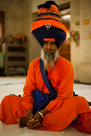 gurudwara: PAONTA SAHIB - MAY 23: The learned elder of the Paonta Sahib gurudwara attends a service in wonderfully beautiful saffron robes and turban May 23, 2009 in Paonta Sahib, Himachal Pradesh, India