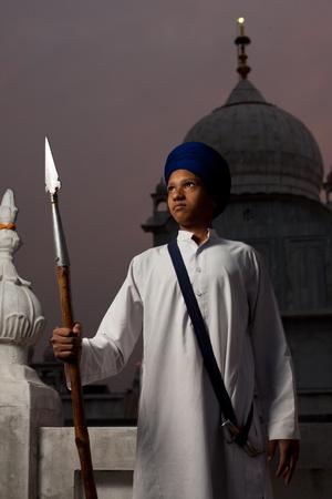 gurudwara: PAONTA SAHIB - MAY 22: A Sikh boy holds a spear at Paonta Sahib Gurudwara, famous for its past warriors May 22, 2009 in Paonta Sahib, Himachal Pradesh, India Editorial