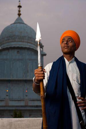 gurudwara: PAONTA SAHIB - MAY 22: A young Sikh man brandishing a spear at the Paonta Sahib Gurudwara, famous for its past warriors May 22, 2009 in Paonta Sahib, Himachal Pradesh, India Editorial