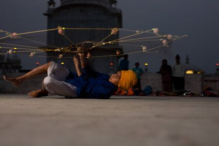 netlike: Paonta Sahib - May 22: A Sikh practices with a net-like weapon at the gurdwara known for its fierce past warriors May 22, 2009 at Paonta Sahib, Himachal Pradesh, India
