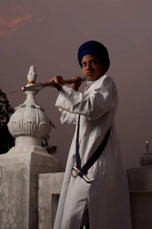 gurudwara: Paonta Sahib - May 22: A Sikh boy holds a spear in an aggressive position at Paonta Sahib Gurudwara, famous for its past warriors May 22, 2009 at Paonta Sahib, Himachal Pradesh, India