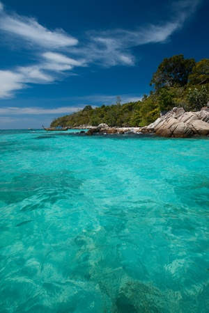 Perfect crystal clear water meet the edge of the island paradse of Ko Lipe, Thailand