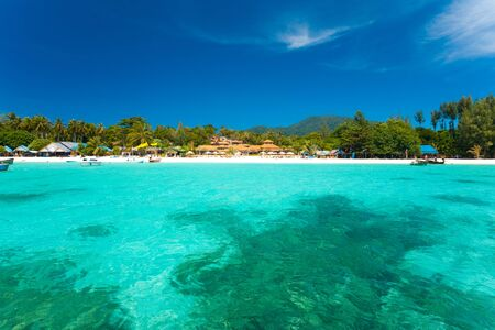 A paradise with perfect crystal clear ocean water and pure white sand beach on Ko Lipe, Thailand