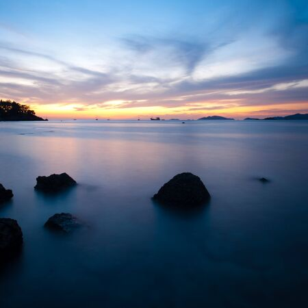 A long exposure on an ocean at sunset on the island paradise of Ko Lipe, Thailand Imagens