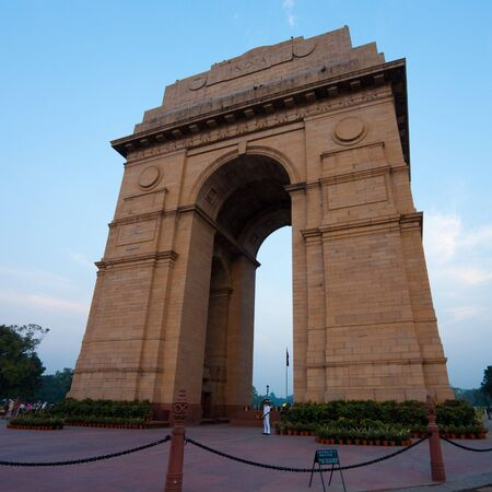 india gate: A beautiful blue sky is visible behind India Gate memorial in the evening at Delhi, India