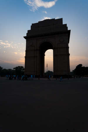 india gate: India Gate memorial is surrounded by the glow of a setting sun in Delhi, India Stock Photo