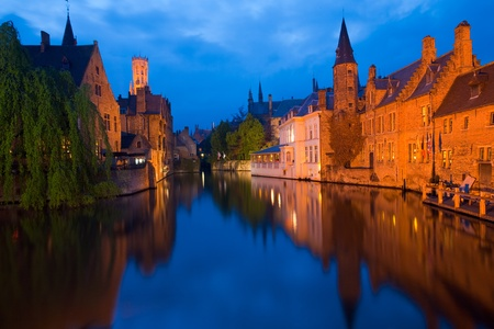 Beautiful brick architecture is reflected in the canal in front of RozenhoedKaai in the old city portion of Brugge, Belgium