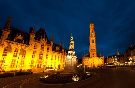 A moody night sky above Grote Markt, the city center of Brugges, Belgium photo