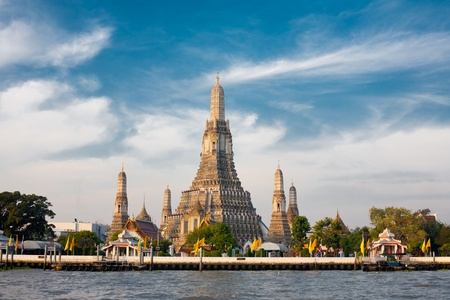 The Temple of Dawn, Wat Arun, on the Chao Phraya river and a beautiful blue sky in Bangkok, Thailand