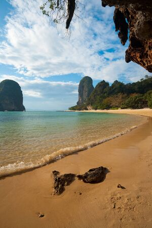 A small wave gently breaks on the shore of Phra Nang beach in Railay, Thailand