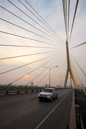 The beautiful Rama VIII cable-stayed suspension bridge at sunset in Bangkok, Thailand. photo