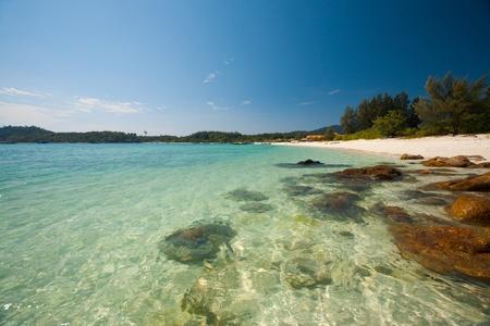 The crystal clear transparent water and rocks on perfect paradise island of Koh Lipe (aka Ko Lipeh), Thailand.  Horizontal