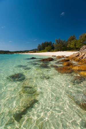 The crystal clear transparent water and rocks on perfect paradise island of Koh Lipe (aka Ko Lipeh), Thailand.  Vertical